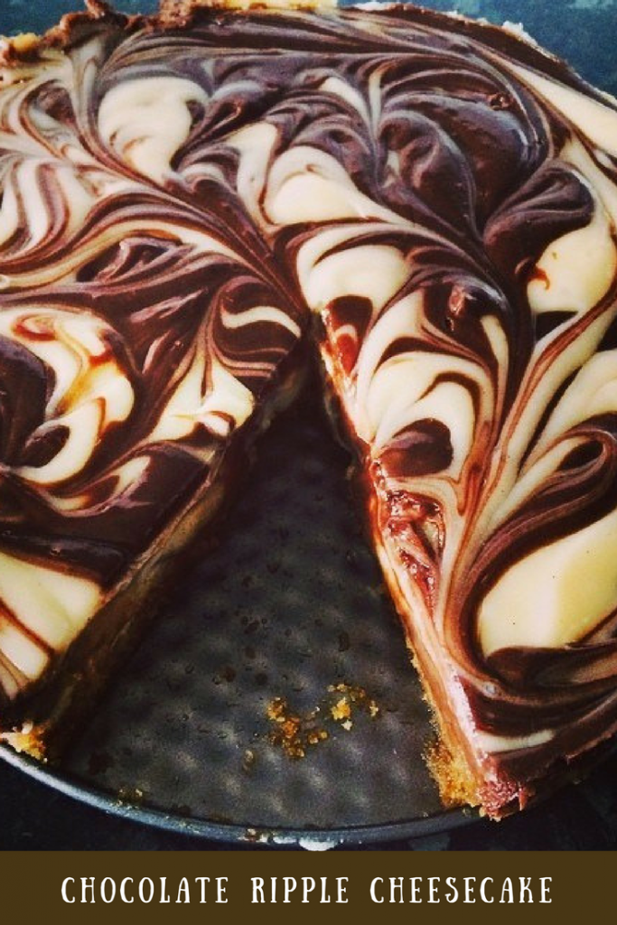 A chocolate ripple cheesecake with one piece missing