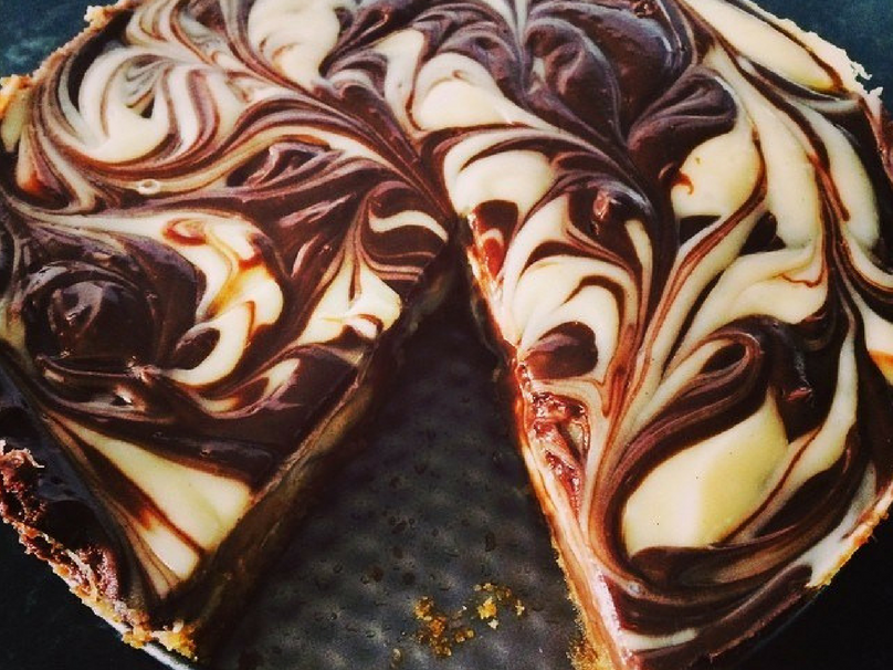 Cooked Chocolate ripple cheesecake with a slice missing