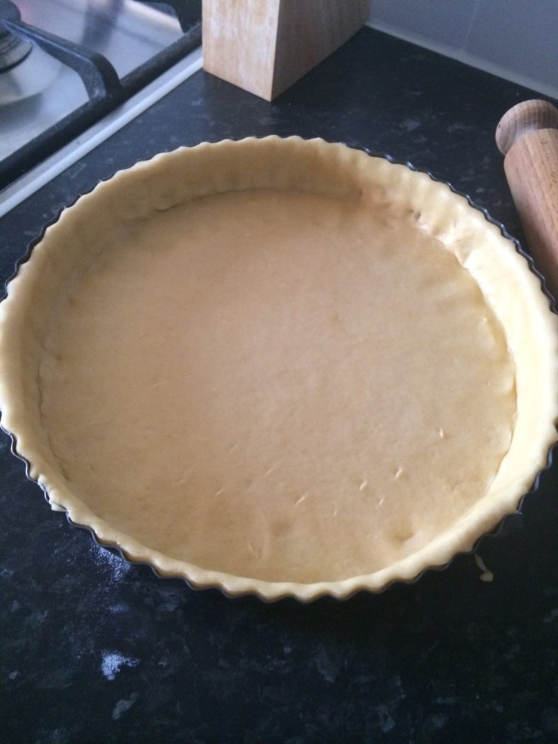 Easy shortcrust pastry - uncooked pastry dough spread in a tin
