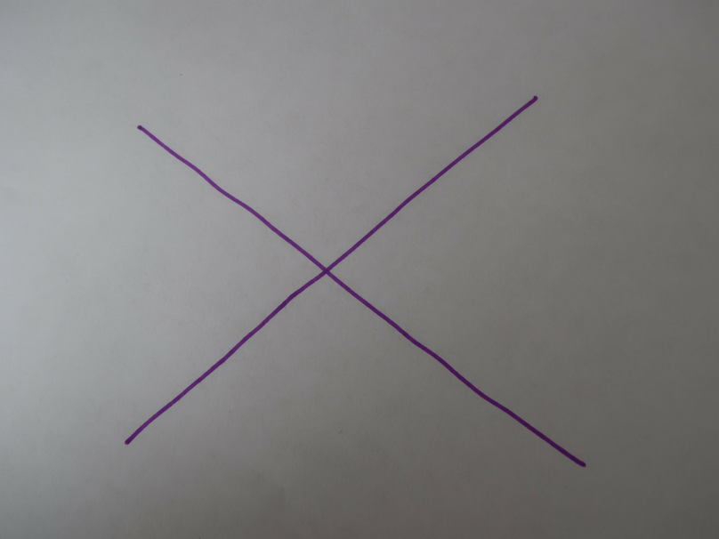 A purple X on a white piece of paper