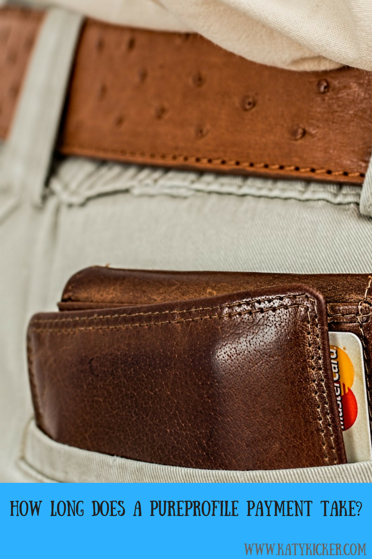 A wallet with Mastercard in a person's pocket and text overlay that says how long does a pure profile payment take?