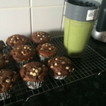 Triple chocolate muffins on a wire cooling rack