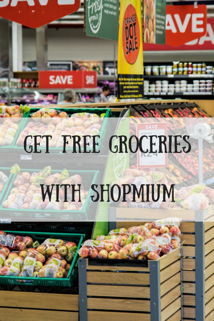 Apples in plastic bags in a grocery store with text overlay that says get free groceries with Shopmium