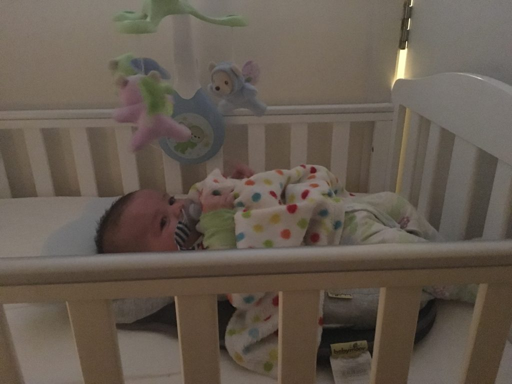 Daisy in her cot at four months old