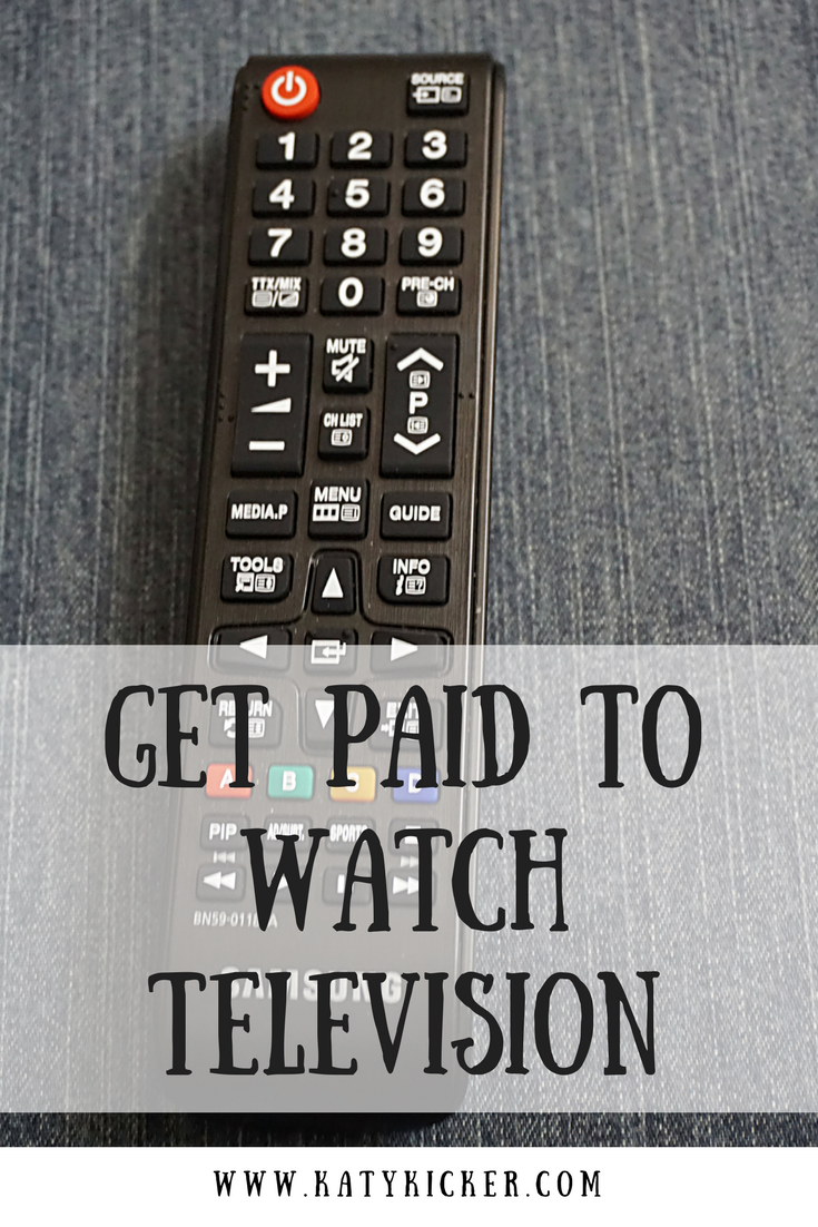 A remote control on a sofa with text overlay that says get paid to watch television