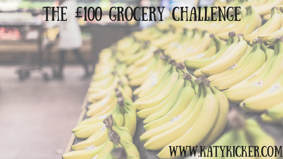 Bananas on display with text displaying the £100 grocery challenge