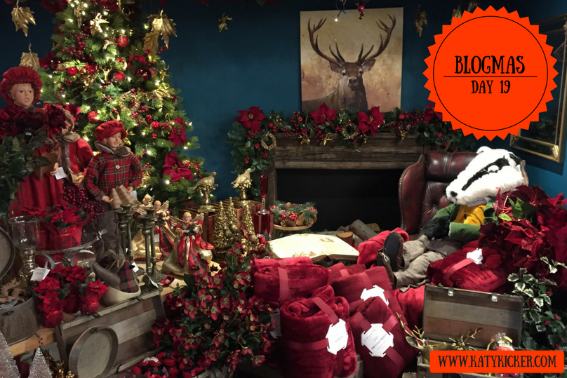 A festive Christmas scene with a badger, fireplace and red and green theme