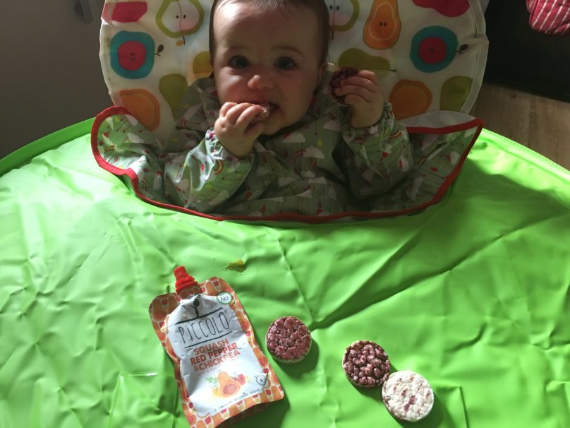 Daisy using her new Tidy Tot Bib and Tray Kit