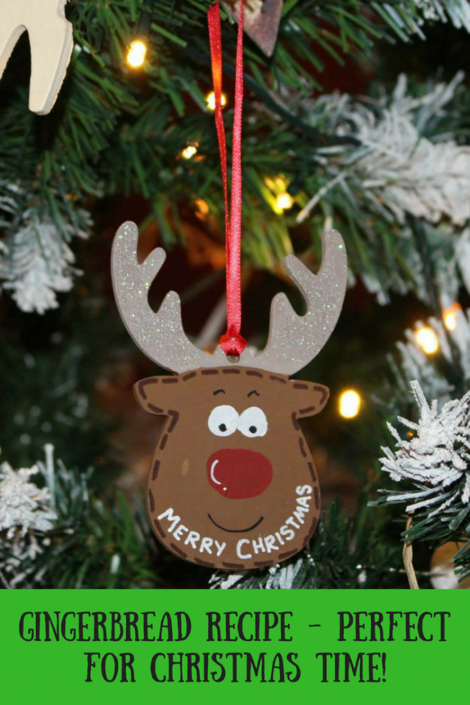 A reindeer Christmas tree ornament that says Merry Christmas and text overlay that says gingerbread recipe - perfect for Christmas time!