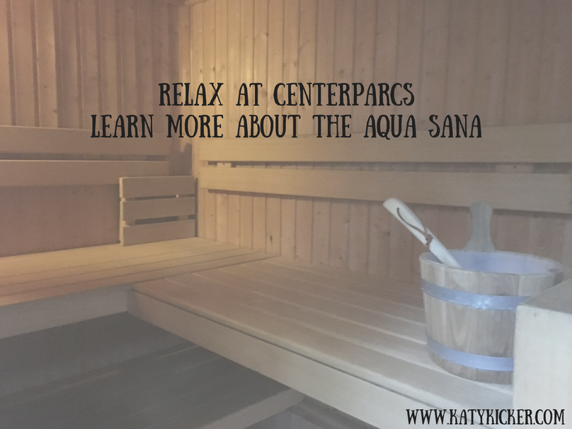 A sauna with a bucket and text overlay that says relax at Centerparcs learn more about the Aqua Sana