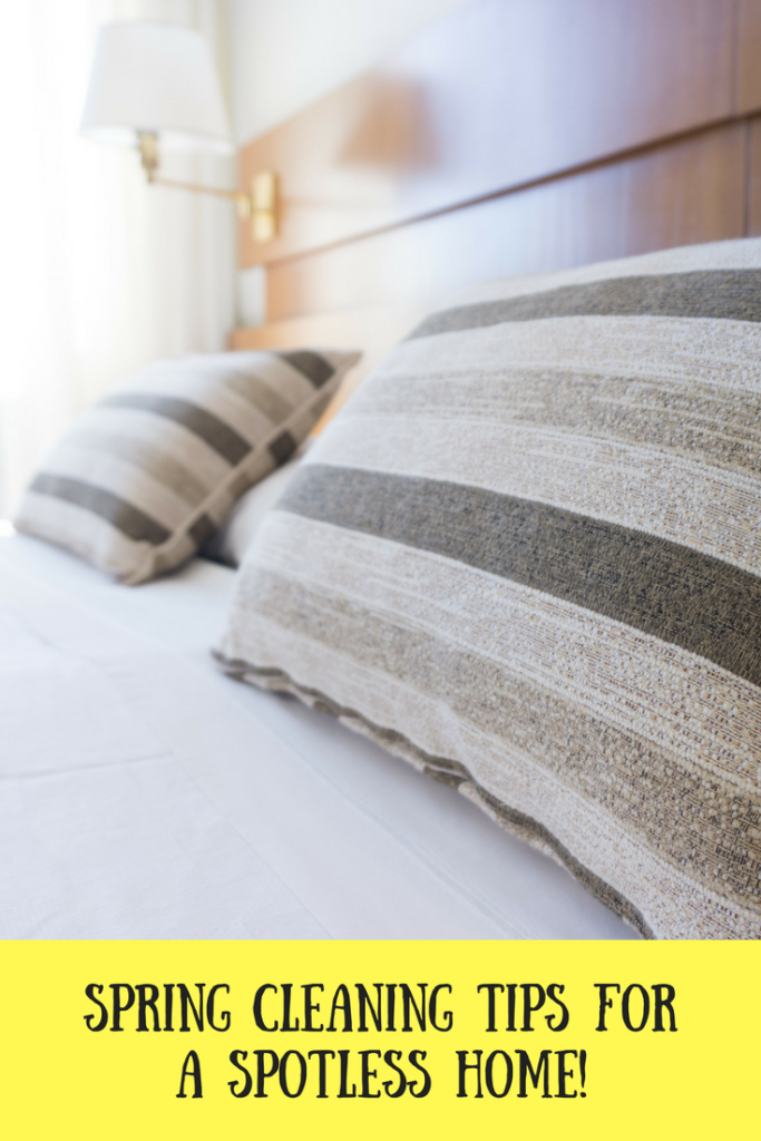 A bed with grey striped pillows on
