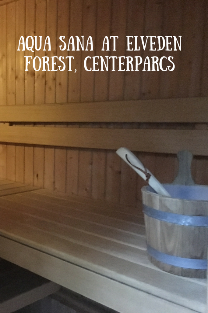 A sauna with ice bucket and text overlay that says Aqua Sana at Elveden Forest, Centerparcs