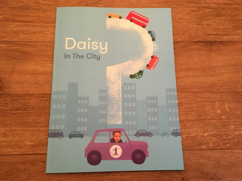 A personalised children's book where my child is featured in a purple car.