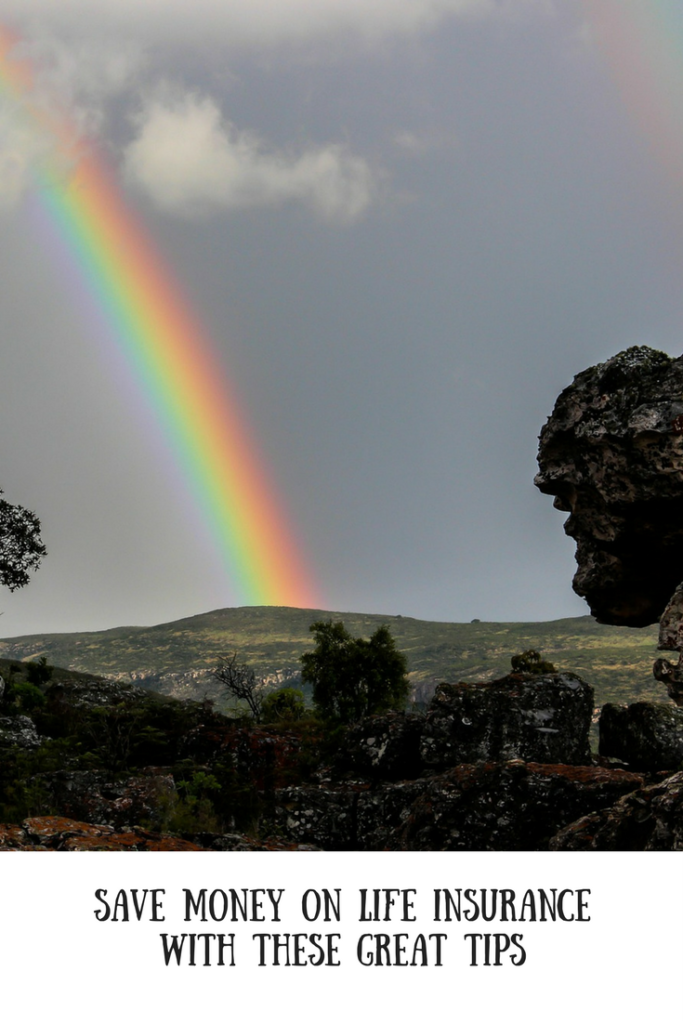 A rainbow on a mountain backdrop with text overlay that says save money on life insurance with these great tips