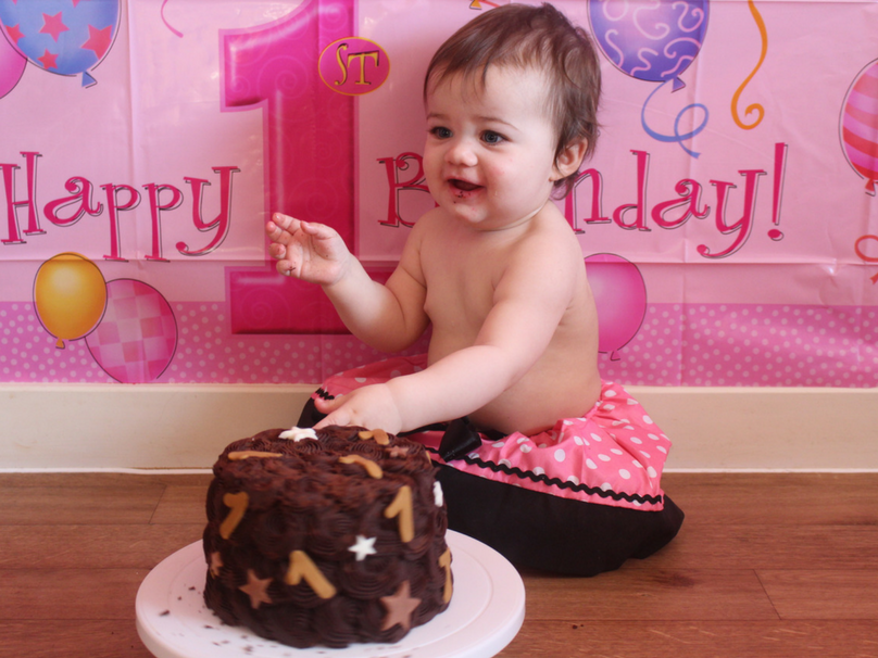 Daisy having a taste of her cake for the first time at her DIY cake smash