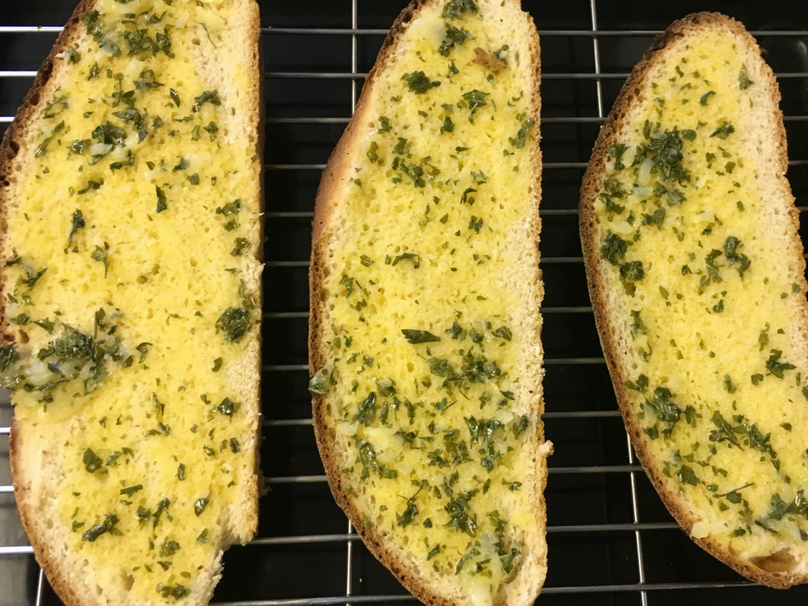 Easy homemade garlic bread - look at the bread once it has been dressed!