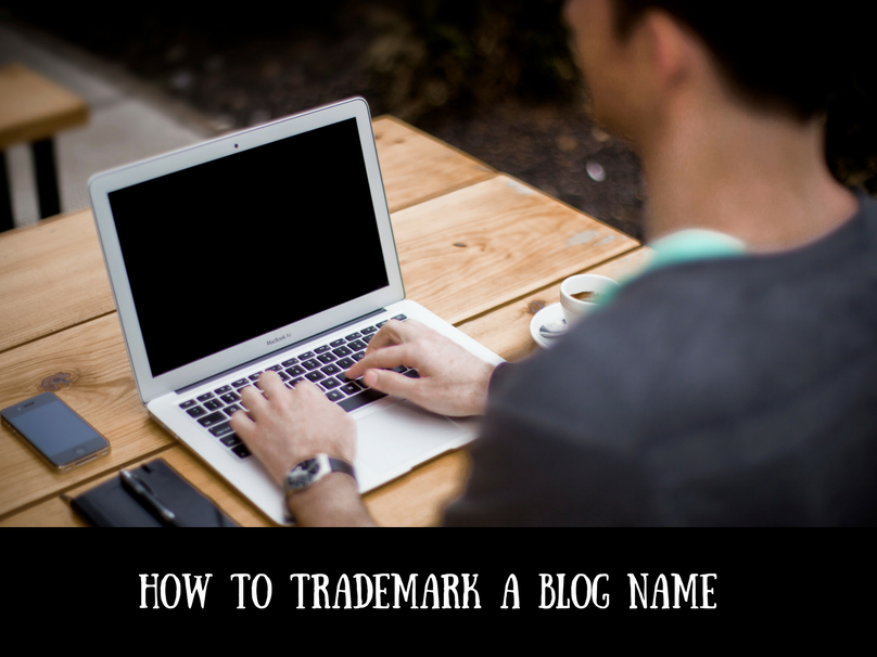 A man typing on a computer at a desk with text overlay that says how to trademark a blog name