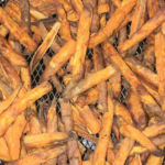 Cooked sweet potato fries with the skins on