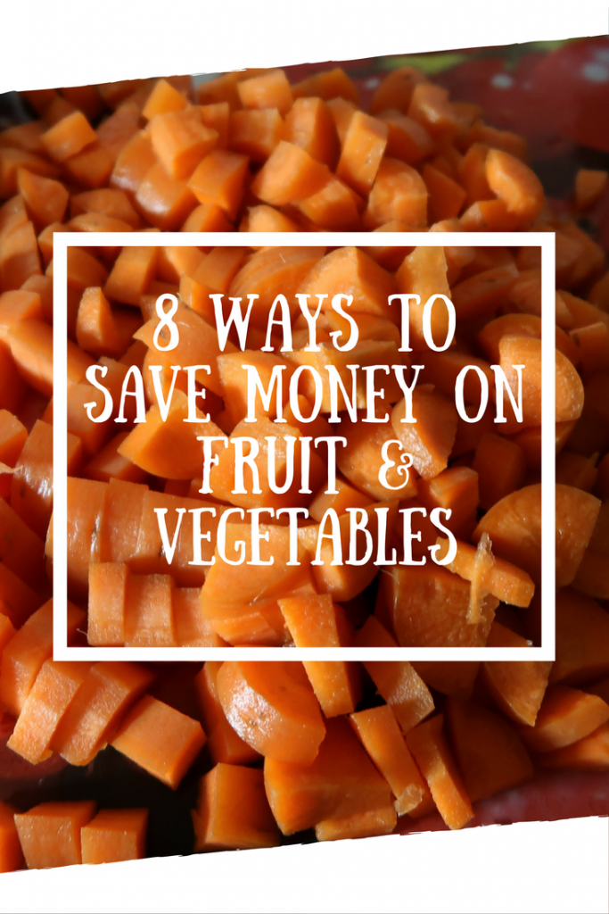 Chopped carrots on a chopping board with a text overlay that says 8 ways to save money on fruit & vegetables