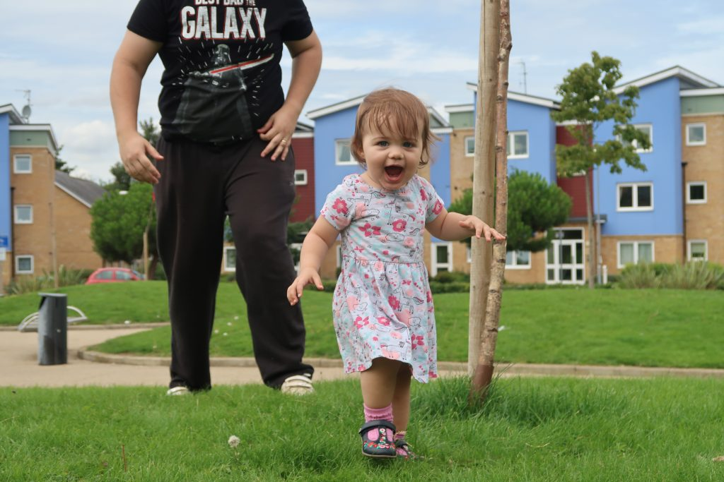 Daisy playing outside with her Daddy at 17 months old