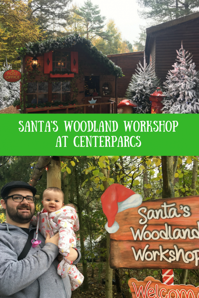 Daisy and Thomas outside the Santa's Woodland Workshop with the welcome sign
