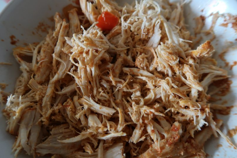 Slow cooker chicken nachos - shred the chicken