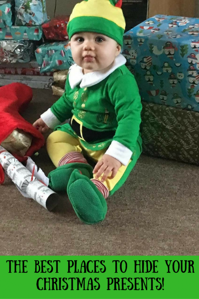 Daisy wearing an elf costume surrounded by Christmas presents and text overlay that says the best places to hide your Christmas presents!