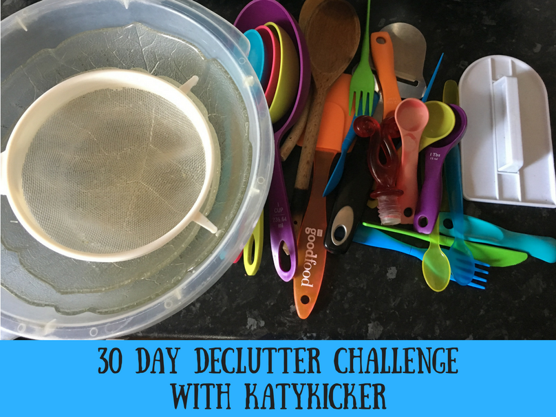 Items that I decluttered from my kitchen including utensils, cake smoother, sieve and glass bowls
