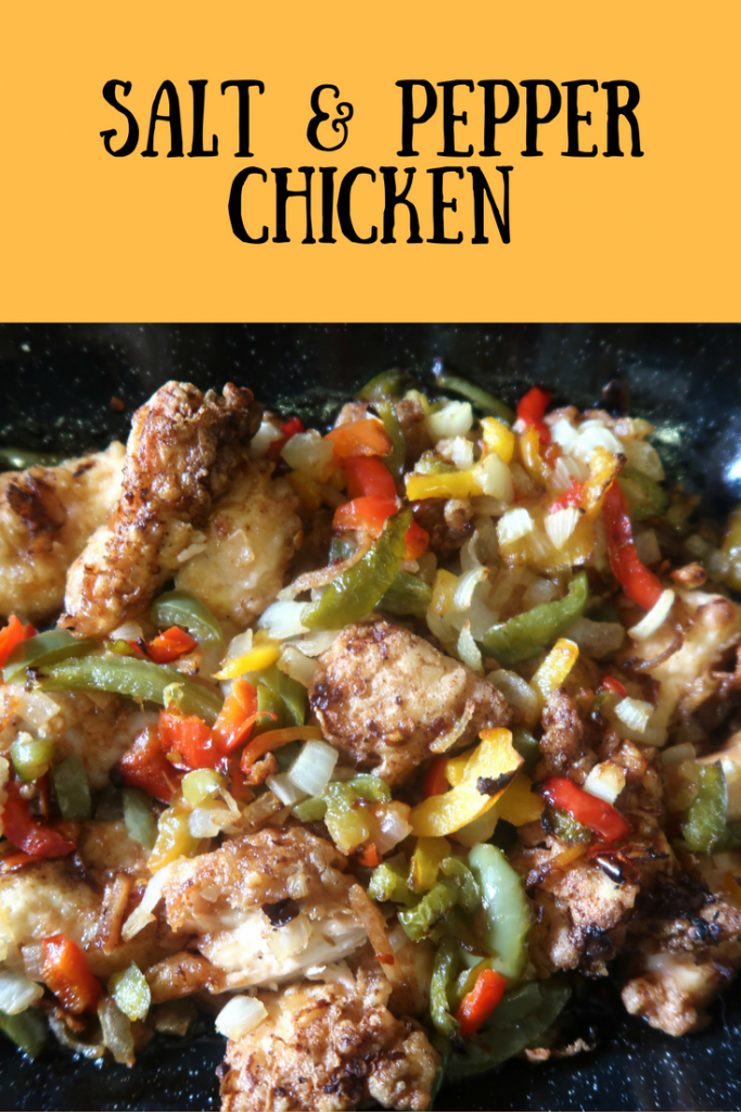 Cooked salt and pepper chicken with green and red peppers and text overlay that says salt & pepper chicken