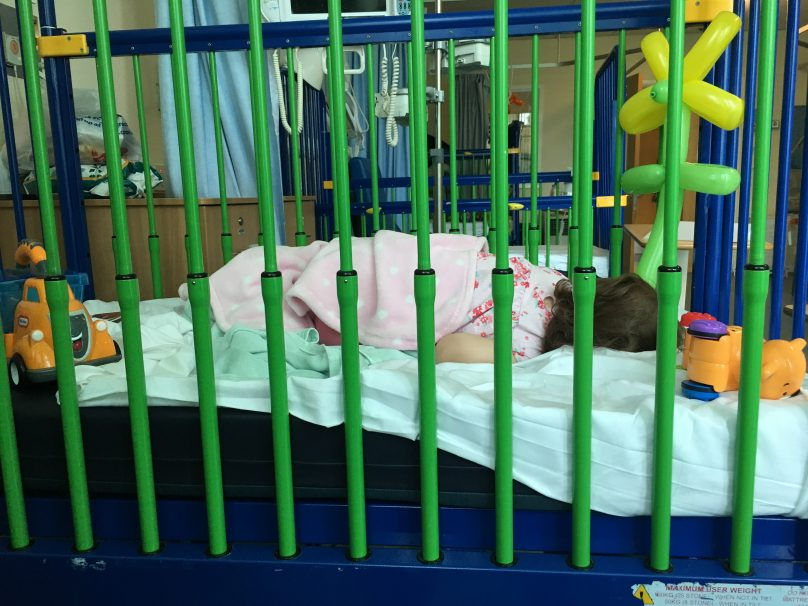 Daisy Staying in hospital asleep in her cot
