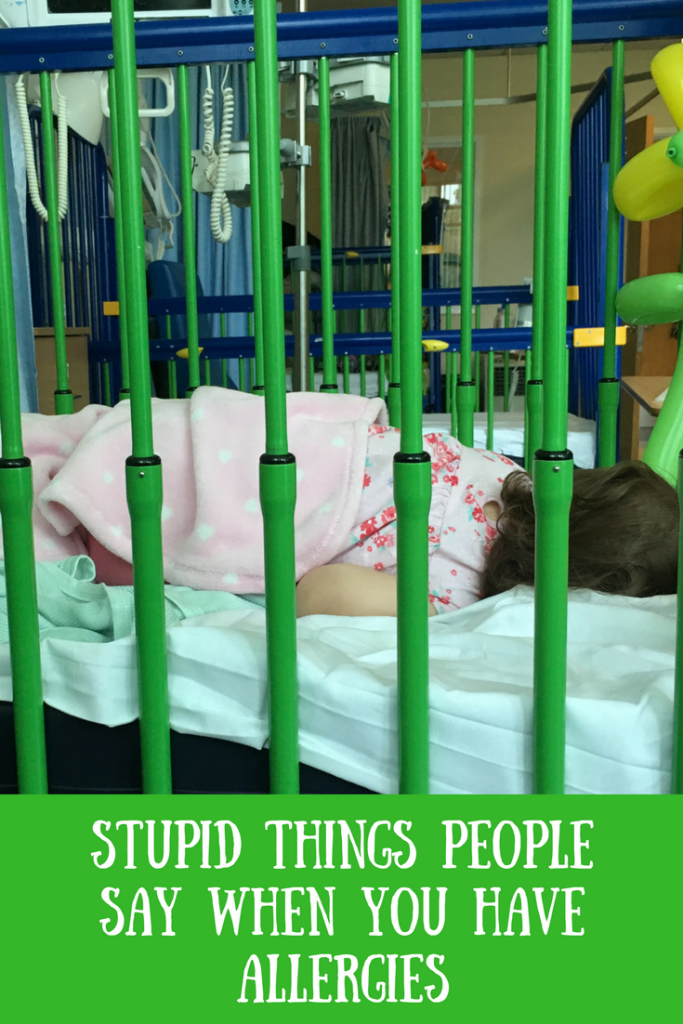 Daisy asleep in a cot in hospital with text overlay that says stupid things people say when you have allergies