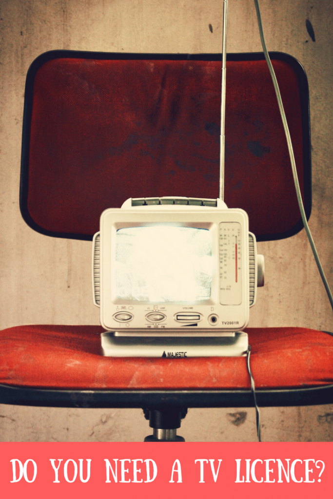 An old TV on a red office chair with text overlay that says do you need a TV licence?