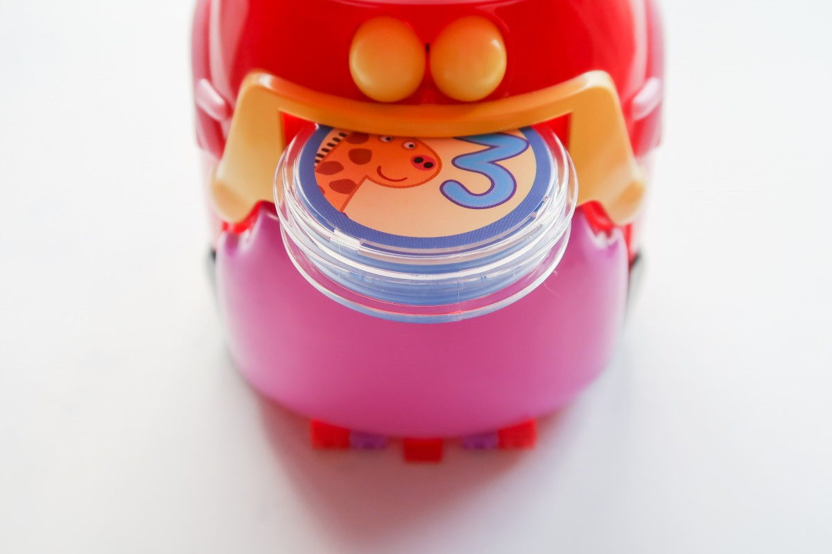 Inserting coins into the Count With Peppa Interactive Money Box