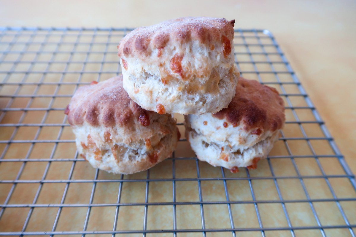 Cheese scones - fluffy, light, cheap, deliciously cheesy scones on a wire cooling rack