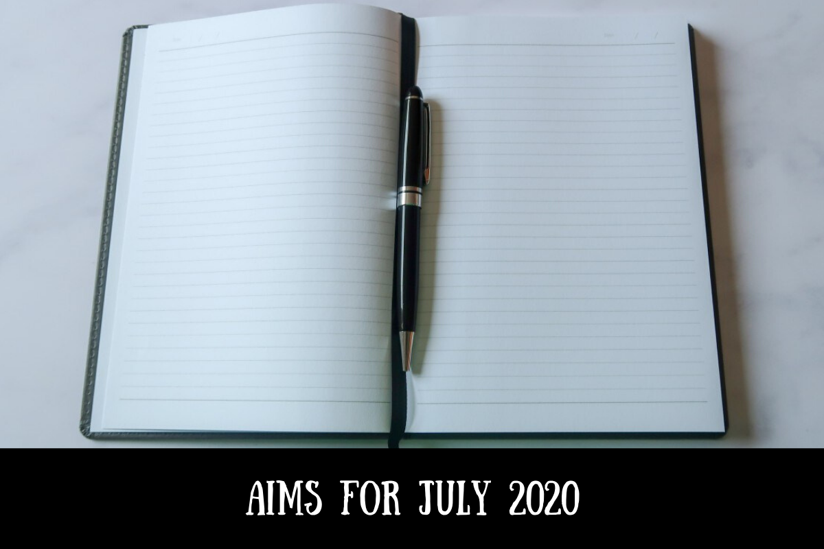 A notebook and pen with text overlay that says Aims for July 2020