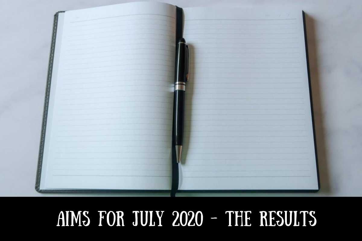 A notebook and pen with text overlay that says Aims for July 2020 - the results
