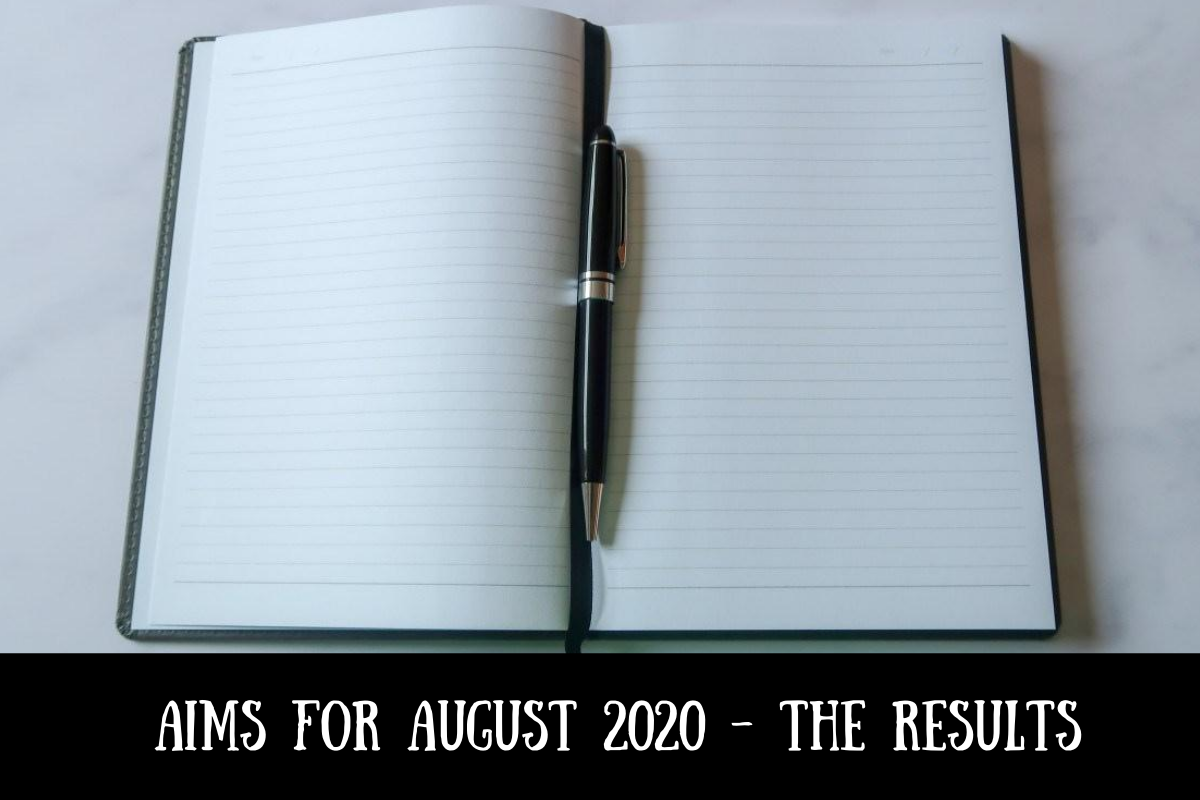 A notebook and pen with text overlay that says Aims for August 2020 - the results