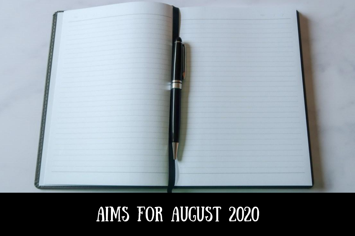 A notebook and pen with text overlay that says my aims for August 2020