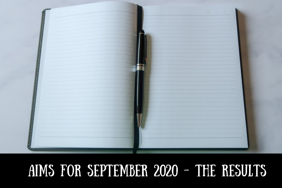A notebook and pen with text overlay that says Aims for September 2020 - the results