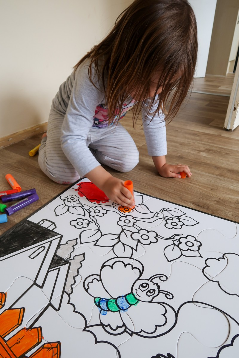 Daisy colouring in her Paint-A-Puzzle from Little Brian Paint Sticks