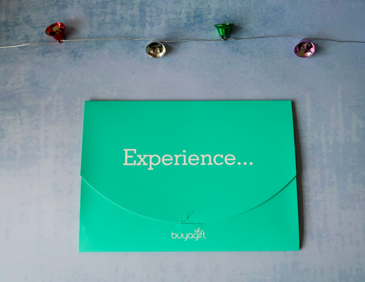 BuyAGift Certificate in a green envelope