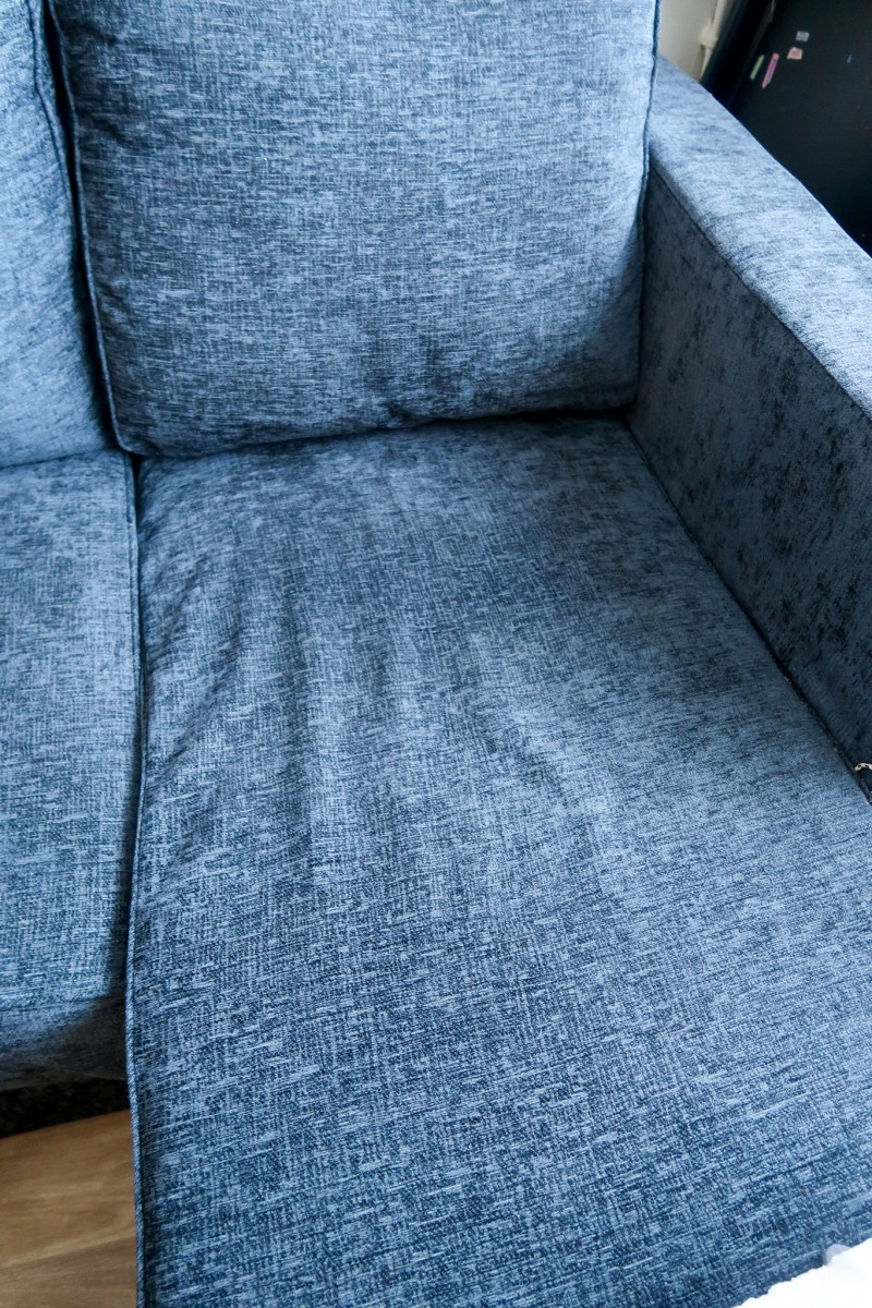 Ato 3 Seat Chaise Sofa in charcoal from Nabru sofas with excess fabric on the chaise end