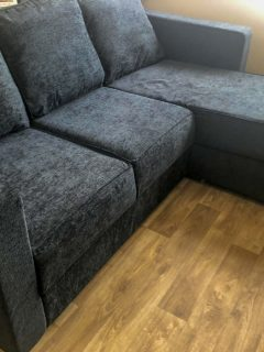 Ato 3 Seat Chaise Sofa in charcoal from Nabru sofas in my living room on a wooden vinyl floor