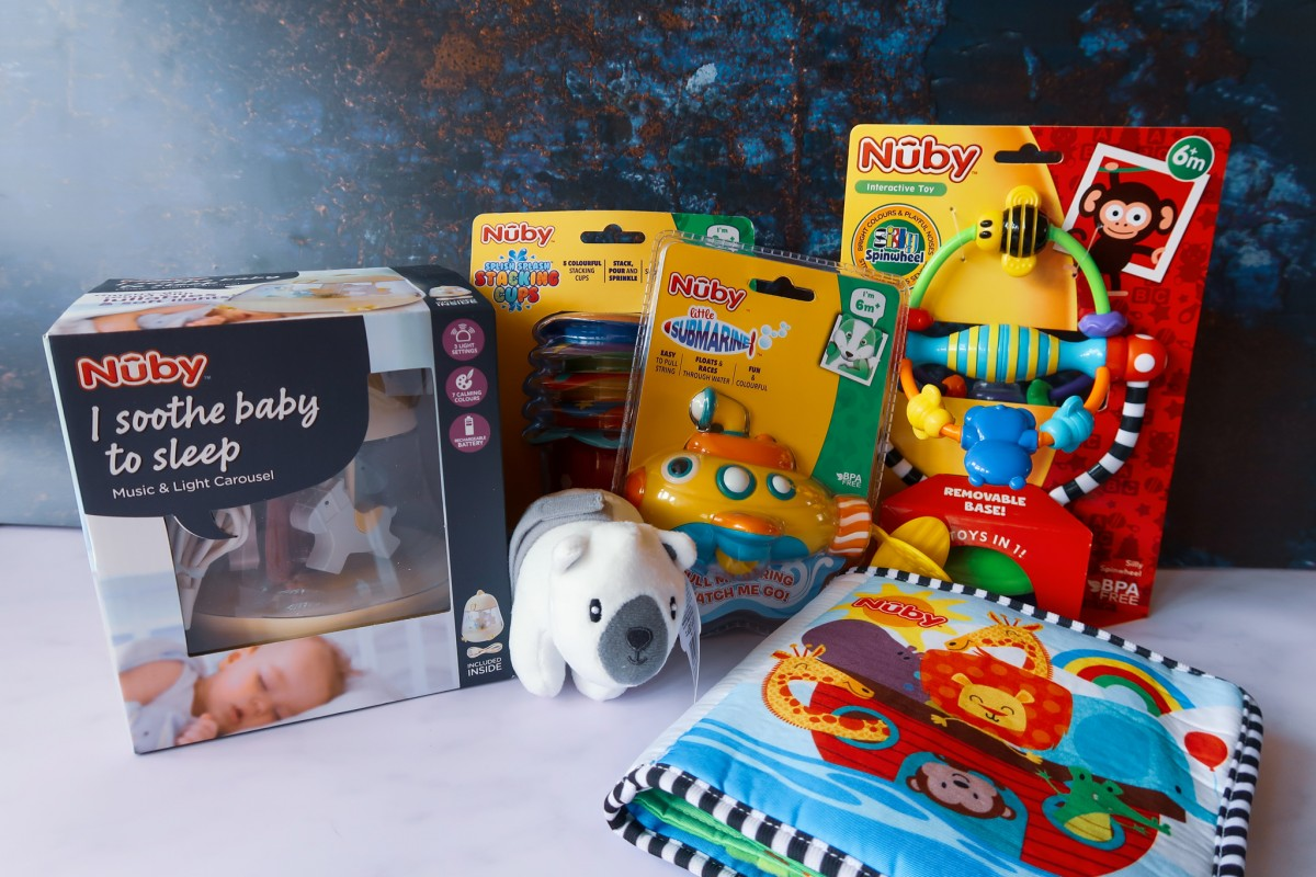 Nuby Santa Surprise Box contents - toys and accessories for a baby aged 0-12 months