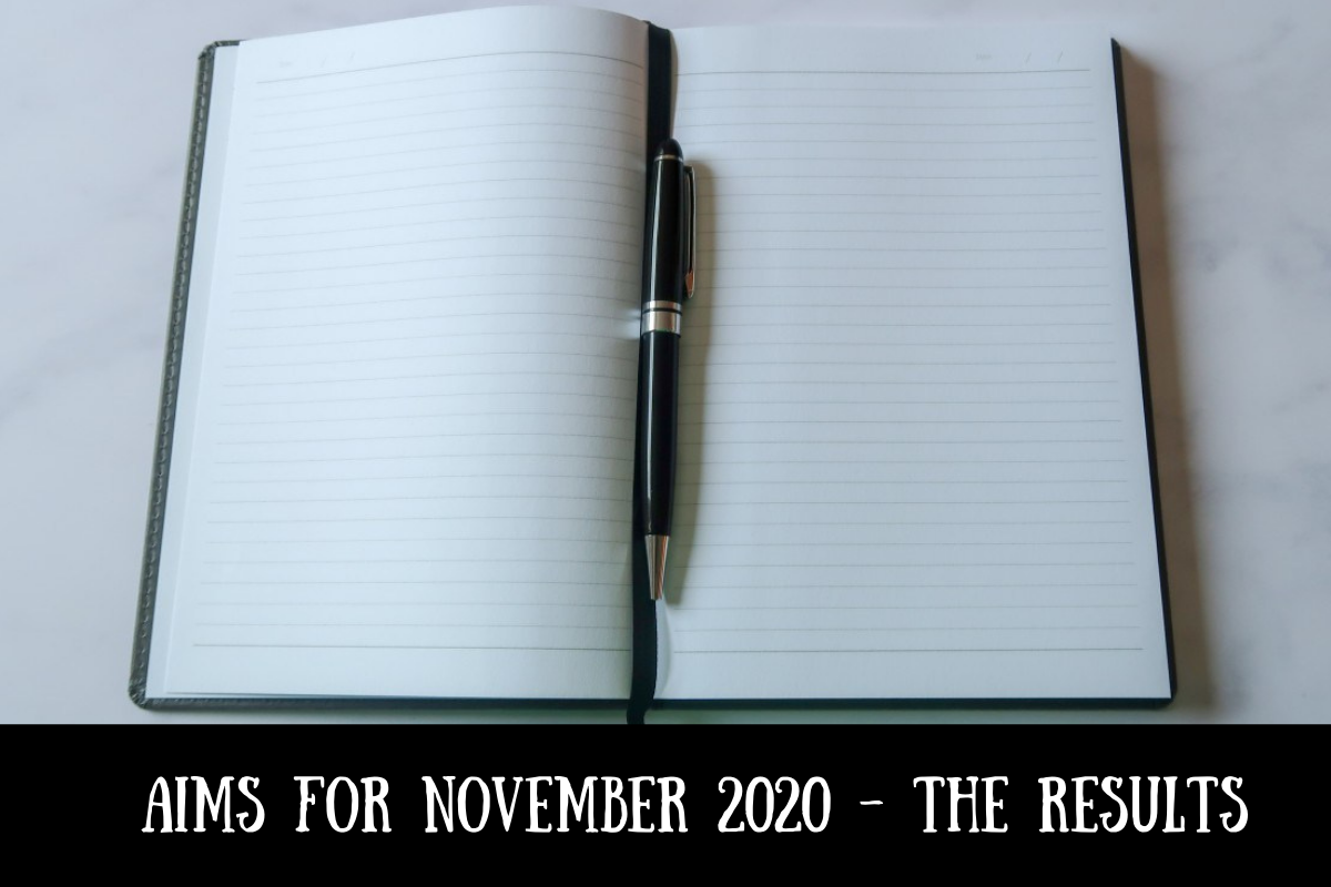 A notebook and pen with text overlay that says Aims for November 2020 - the results