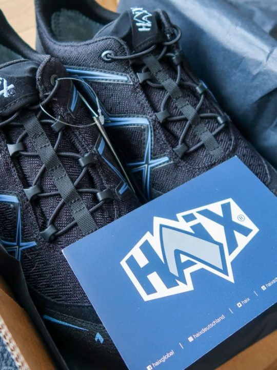 Haix shoes - black with blue lines on and elasticated lashes in a cardboard box