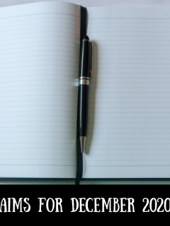 A notebook and pen with text overlay that says aims for December 2020
