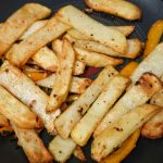Cooked salt and pepper chips in a wok
