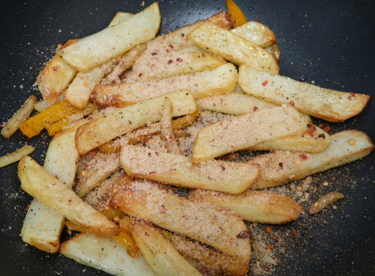 Salt and pepper chips with seasoning on before being mixed
