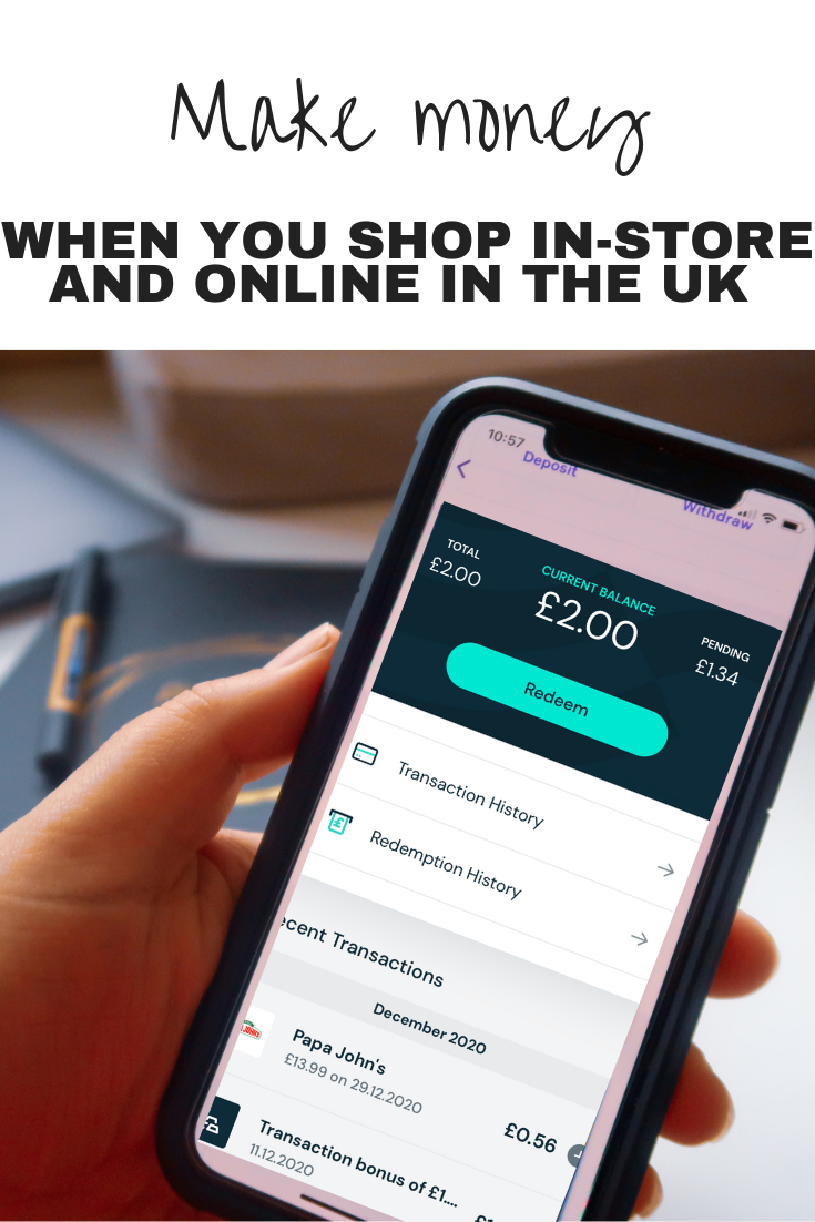 A hand holding a mobile phone which displays the Airtime Rewards app and shows a £2.00 current balance and £1.34 pending from Papa Johns spending